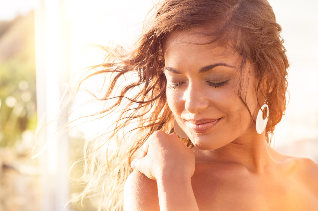 TitanCryo | Cryotherapy Equipment | Closeup Of Smiling Young Woman With Eyes Closed At Sunset